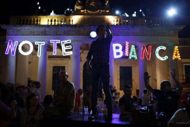 A reveller dances on a platform during Notte Bianca (White Night) celebrations at St George's Square in Valletta on October 3. Photo: Darrin Zammit Lupi