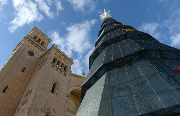The seaside village of Birzebbuga unveils its record breaking, seven-storey Christmas tree, rising 22 metres from its base to the top of the crowning star, at the parish square on December 1. Photo: Matthew Mirabelli