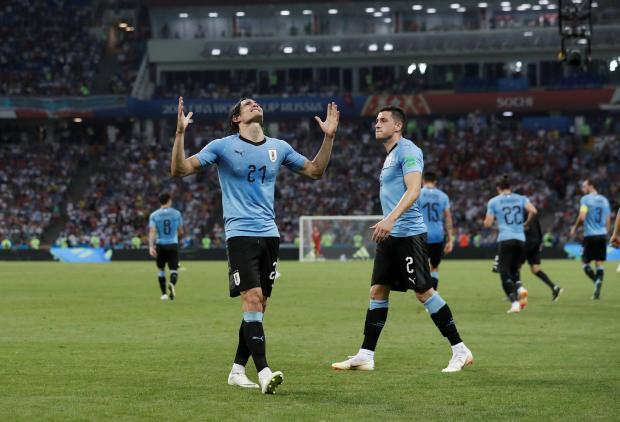 Uruguay's Edinson Cavani celebrates scoring their second goal.