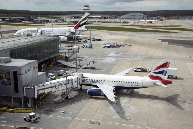 Plane's tyre BURSTS during take-off at London Gatwick airport