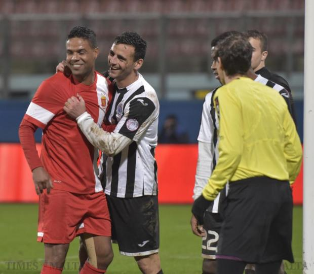 Hibernians' Clayton Failla and Valletta' s Abdelkarim Nafti joke around during their Premier League football match at the National Stadium in Ta' Qali on December 20. Photo: Mark Zammit Cordina