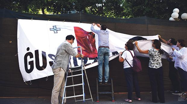 Activists putting the banner up yesterday morning.