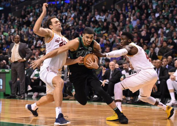 Boston Celtics forward Jayson Tatum (0) drives to the basket between Indiana Pacers forward Bojan Bogdanovic (44) and guard Victor Oladipo (4) during the second half at TD Garden. Photo Credit: Bob DeChiara-USA TODAY Sports