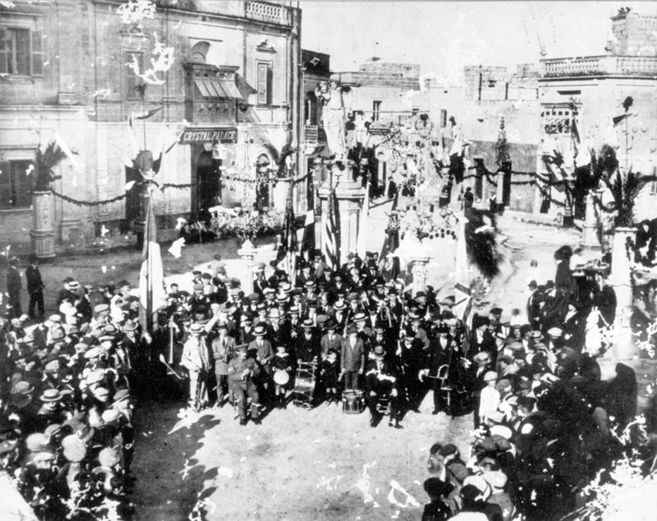 The band in Piazza Chiesa, Luqa, during festa time (c. 1920).