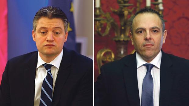 Konrad Mizzi. Right: Keith Schembri.