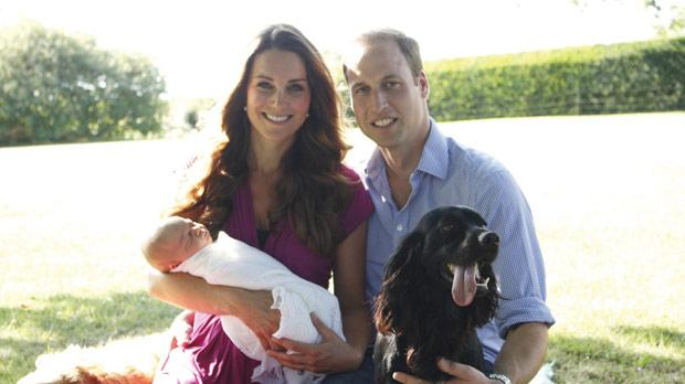 Handout photo taken by Michael Middleton, the Duchess's father, in early August and supplied by Kensington Palace of the Duke and Duchess of Cambridge as they sit with their son Prince George in the garden of the Middleton family home in Bucklebury, Berkshire, surrounded by Tilly the retriever (a Middleton family pet), and Lupo, the couple's cocker spaniel.