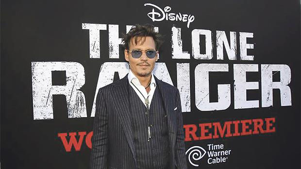 Johnny Depp wore Ralph Lauren at the world premiere of The Lone Ranger in June 2013. Photo: Mario Anzuoni/Reuters