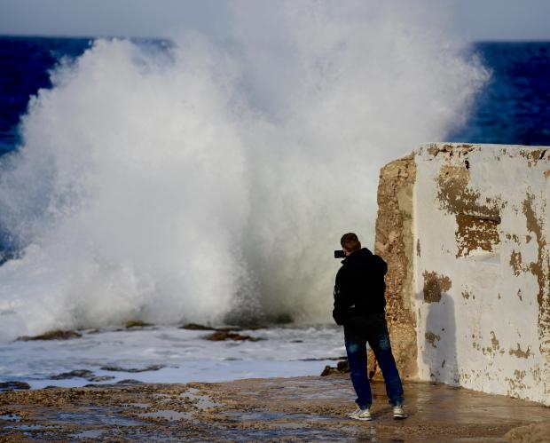 A Man gets close to take pictures of strong waves in Cirkewwa on December 29. Photo: Mark Zammit Cordina
