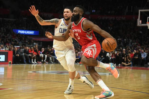 Houston Rockets guard James Harden (13) controls the ball defended by LA Clippers guard Austin Rivers (25) during the forth quarter at Staples Center. Photo Credit: Richard Mackson-USA TODAY Sports