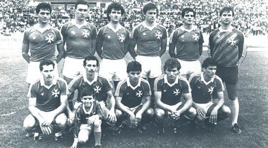 Malta vs Sweden 1-2 (Nov. 17, 1985 World Cup). Standing (from left): John Holland, John Buttigieg, Ray Vella, Michael Woods, Martin Scicluna, John Bonello. Squatting: J.J Aquilina, Leonard Farrugia, Carmel Busuttil, Martin Gregory, Michael Degiorgio.