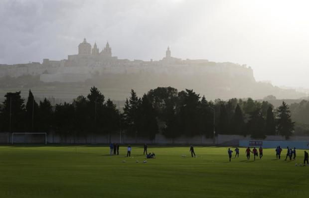 Footballers train at the Ta' Qali Training Ground beneath Malta's old capital, the medieval fortified city of Mdina, in Ta' Qali on December 21. Photo: Darrin Zammit Lupi