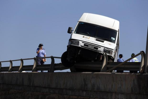 A van driver has a lucky escape after he lost control of his vehicle, crashing into the metal barrier of the overpass linking the Mriehel and Marsa Hamrun bypasses on July 30. The man walked away with slight injuries, but the blocked overpass left hundreds of drivers in a tailback. Photo: Darrin Zammit Lupi