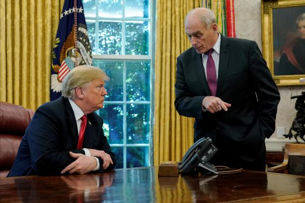US President Trump speaks to Chief of Staff Kelly after an event with reporters in the Oval Office at the White House in Washington.