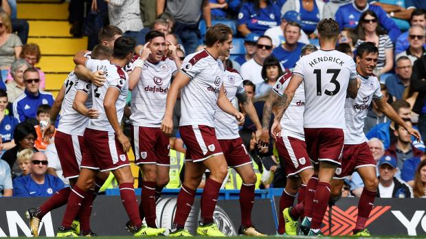 Burnley's Sam Vokes celebrates with teammates after scoring their third goal.