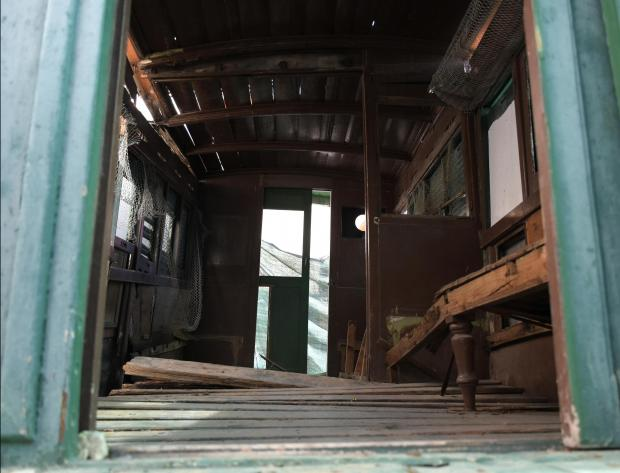 The inside of what's left of an old train cabin in Birkirkara before being taken away for restoration on April 7. PHOTO: MARK ZAMMIT CORDINA