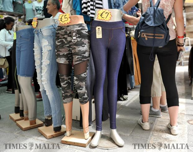A shopper walks round a line of mannequins at the Valletta open market on May 2. Photo: Chris Sant Fournier
