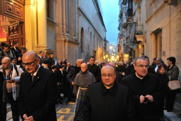 Archbishop Charles Scicluna (centre) leads the Our Lady of Sorrows procession in Valletta on March 27. Archbishop Emeritus Paul Cremona (right) was also present. Photo: Jason Borg