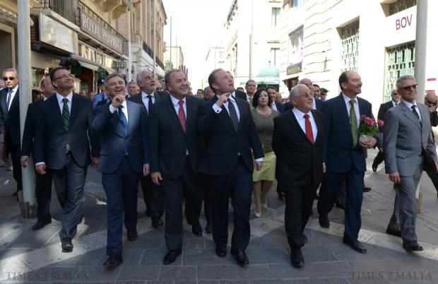Prime Minister Joseph Muscat accompanied by Opposition leader Simon Busutill and other members of parliament make their way to the new Parliament building on May 4. Photo: Matthew Mirabelli
