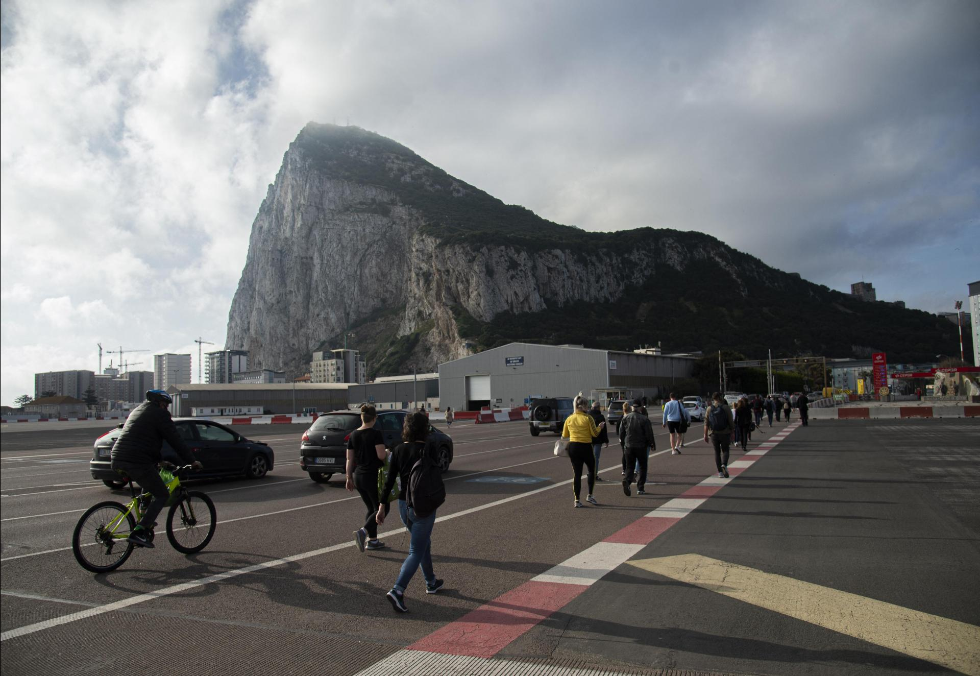 Spaniards cross the border between Spain and Gibraltar to go to work on April 6, 2021.