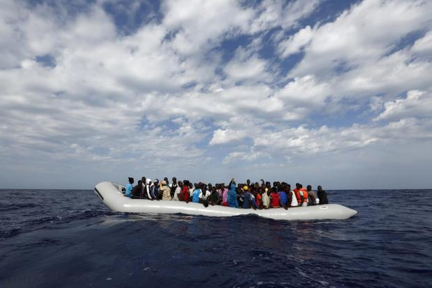 A rubber dinghy with 106 sub-Saharan Africans on board waiting to be rescued by the NGO Migrant Offshore Aid Station (Moas) is seen off the Libyan coast on October 4. Moas, a privately-funded humanitarian initiative, began operating at the end of August and has assisted in the rescue of some 2,200 migrants crossing from Libyan shores towards Europe. Photo: Darrin Zammit Lupi/Moas
