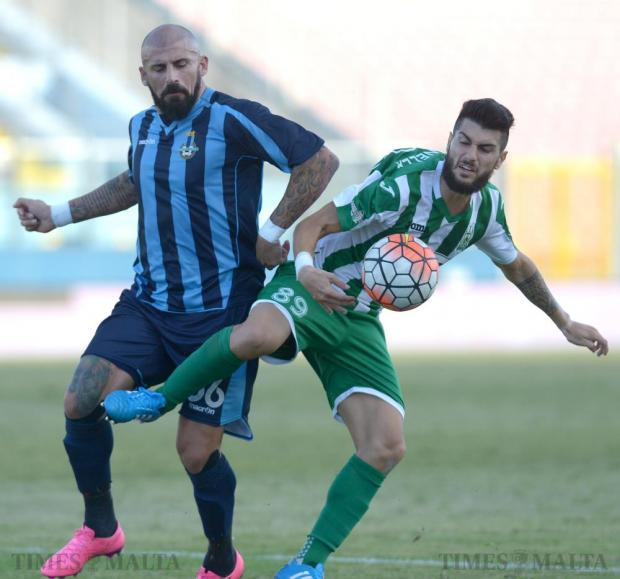 Shielding the ball... Floriana striker Mario Fontanella (right) defends possession from Sliema's Luke Dimech at the National Stadium in Ta'Qali on October 3. Photo: Matthew Mirabelli
