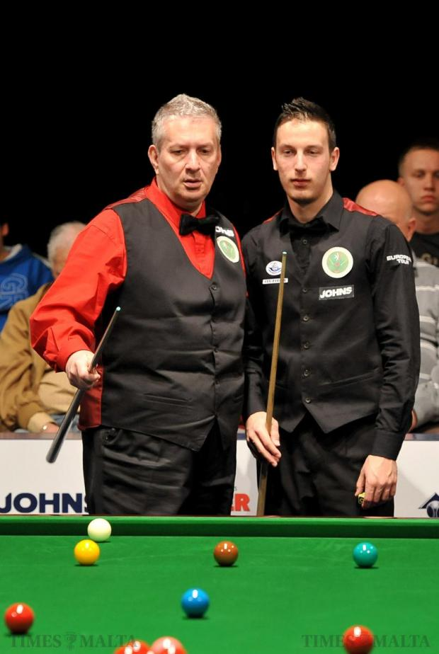 Snooker players Tony Drago and Brian Cini 'study' the table during the doubles semifinal between Malta and Wales at the Dolmen Hotel in Qawra on April 1. Photo: Chris Sant Fournier