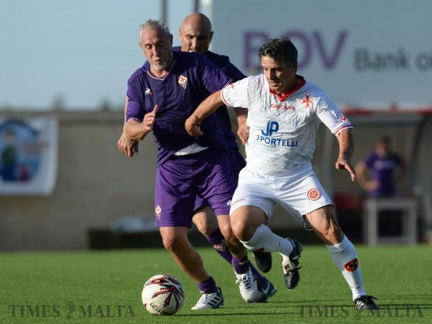 Ex Malta International Carmel Busutill (right), takes part in a match at the Centenary Stadium on May 27, against Glorie Viola players. The Viola Club Malta lined-up this friendly to mark the club's 50th anniversary. Photo: Matthew Mirabelli
