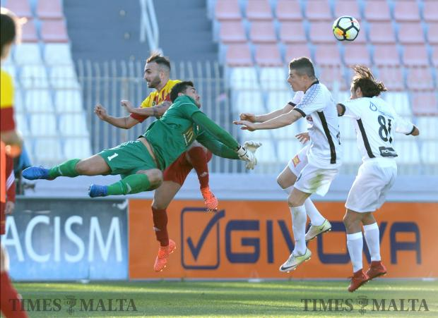 Hamrun goalkeeper Steve Sultana punches the ball away after a shot on goal during their BOV Premier League match against Hamrun at the National Stadium in Ta'Qali on December 9. Photo: Matthew Mirabelli