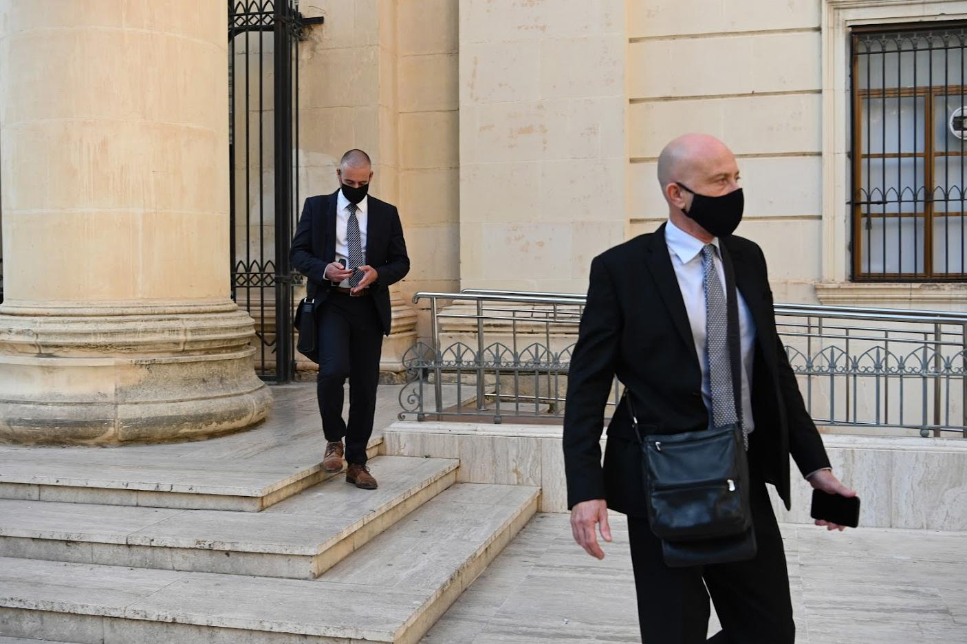 Brian Tonna and Karl Cini exiting court in a file photo.jpg
