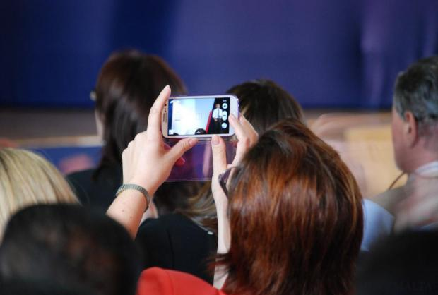 Nationalist MP Claudette Buttigieg takes an image with her mobile of party leader Simon Busuttil during the party's first ever general convention on October 26. Photo: Mark Zammit Cordina