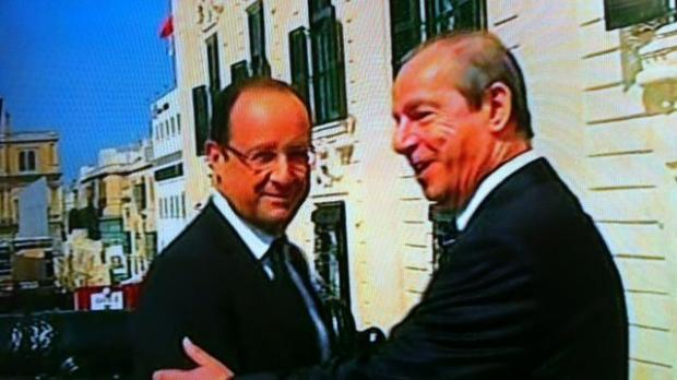 Dr Gonzi greets French President Francois Hollande.