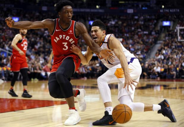 Toronto Raptors forward OG Anunoby (3) defends against Phoenix Suns guard Devin Booker (1) at the Air Canada Centre. Toronto defeated Phoenix. Photo: John E. Sokolowski-USA TODAY Sports.