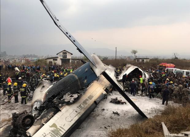 Wreckage of an airplane is pictured as rescue workers operate at Kathmandu airport.