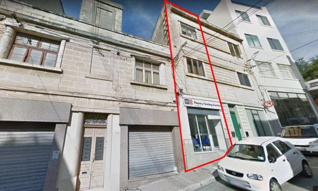 The highlighted part shows the building which crashed to the ground. The building to the left is now a construction site. Photo: Google Maps
