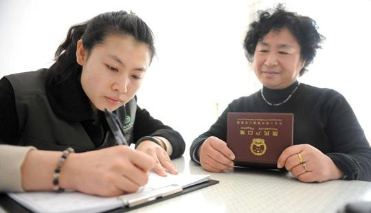 A Chinese census worker gathering data from an elderly resident at her home in Beijing. Photo: AFP