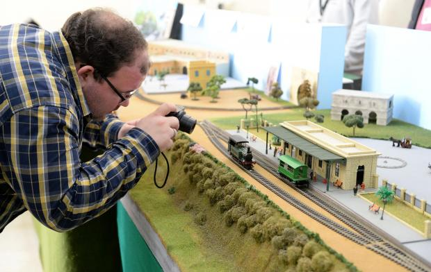 An enthusiast snaps a photo of an old railway station during an exhibition held at the old railway station in Hamrun on January 28. Photo: Matthew Mirabelli