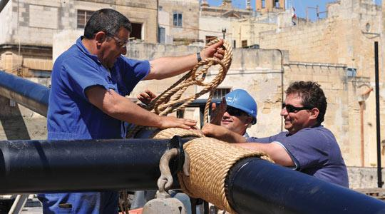 Dockyard workers putting up the sheerlegs at Il-Maċina yesterday. Photo: Chris Sant Fournier.
