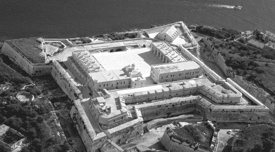 Spot the difference... The historic Fort Manoel (Photo: airphoto.com.mt) contrasts sharply with Tigné Point.