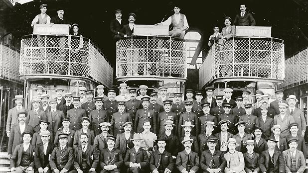 Macartney and McElroy (seventh and eighth from right) with the staff at the Marsa Depot.
