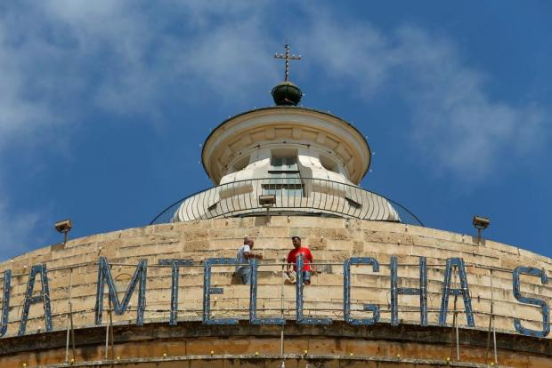 Enthusiasts walk on the dome of the Church of the Assumption of Our Lady, commonly known as the Rotunda of Mosta during celebrations marking the village feast in Mosta on August 15. Photo: Darrin Zammit Lupi