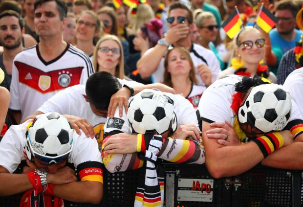 Despair among Germany fans. Photo: Reuters