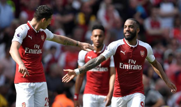 Arsenal's Alexandre Lacazette celebrates with Granit Xhaka after scoring their fourth goal.