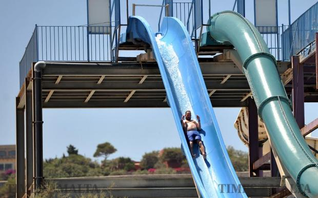 A man enjoyed a water slide at the Splash and Fun park in Bahar ic-Caghaq on June 22. Photo: Chris Sant Fournier