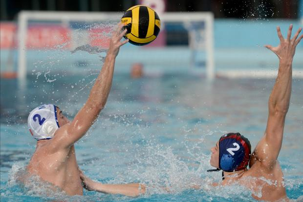 Malta's Nicholas Bugelli passes the ball passed Belarus's Kanstantin Averka during their European Water Polo Championship play-off match at the National Pool in Tal Qroqq on March 3. Photo: Matthew Mirabelli