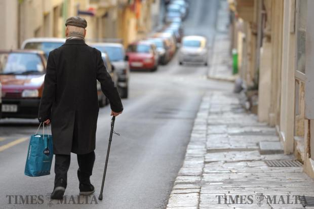 An elderly man makes his way down a street in Valletta on January 31. Photo: Matthew Mirabelli
