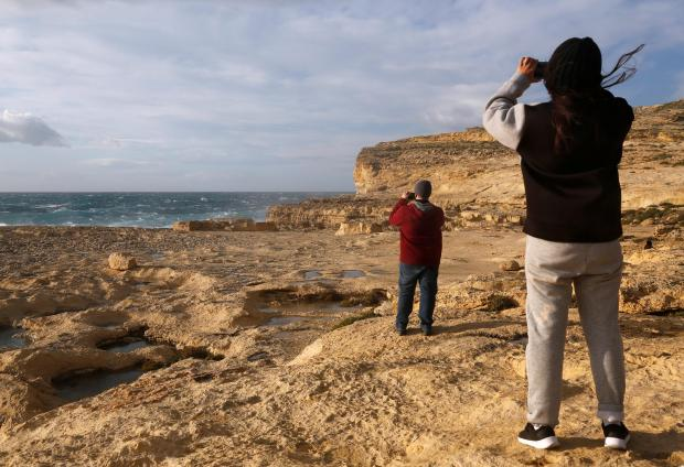 People take pictures of the site where the Azure Window collapsed. Photo: Reuters