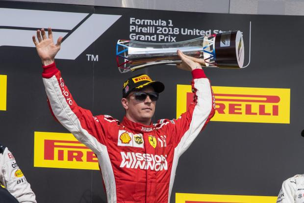 Kimi Raikkonen celebrates his victory at the US Grand Prix.