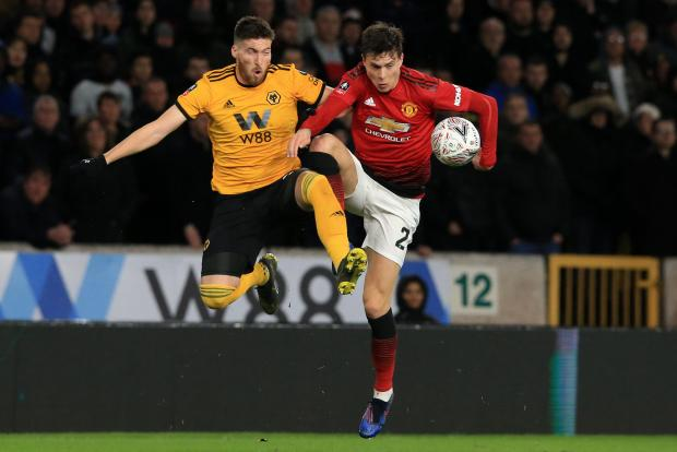 Wolves' Matt Doherty (L) vies with Man. Utd's Victor Lindelof (R) during the FA Cup quarter-final.
