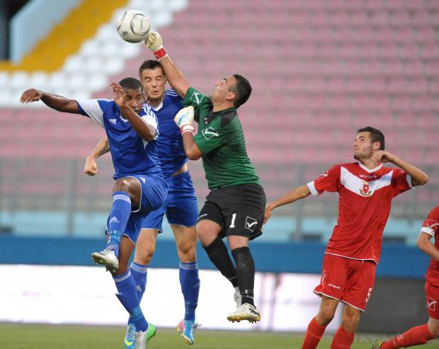 Vittoriosa goalkeeper Jean-Matthias Vella punches the ball away during their Premier League match against Mosta on August 25. Mosta won the match 2-0. Photo: Matthew Mirabelli