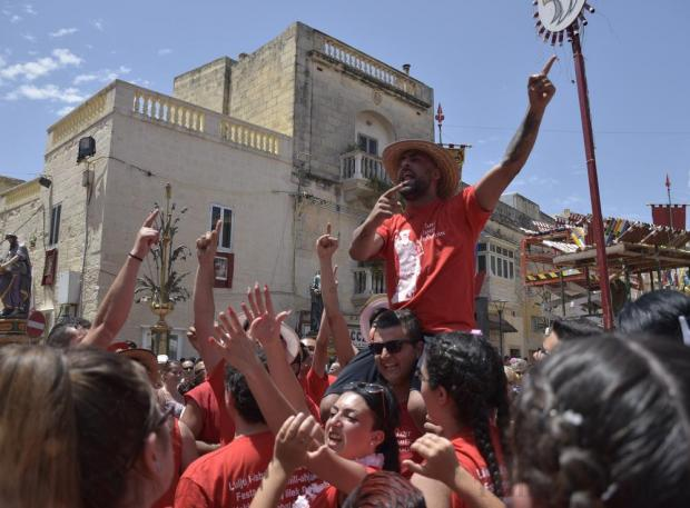 Feast goers celebrate during the feast of St Paul in Rabat on July 3. Photo: Mark Zammit Cordina
